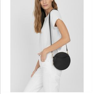 Cuyana mini circle belt bag.